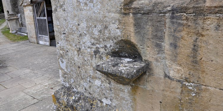 North Cerney Holy water stoop south wall of south transept -